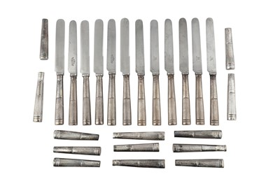 Lot 51-A mixed selection of George III sterling silver dessert knife handles, London 1812 by Moses Brent