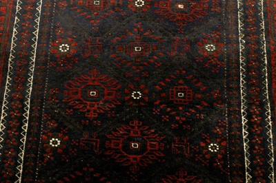 Lot 33 - AN ANTIQUE BALOUCH RUG, NORTH-EST PERSIA