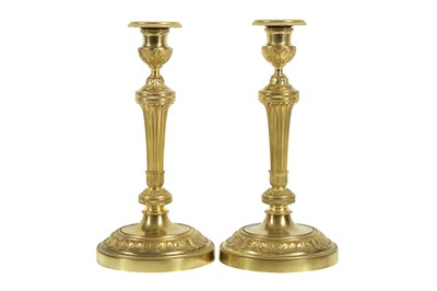 Lot 110 - A PAIR OF 19TH CENTURY FRENCH GILT BRONZE CANDLESTICKS AFTER THE MODEL BY CLAUDE GALLE, PARIS