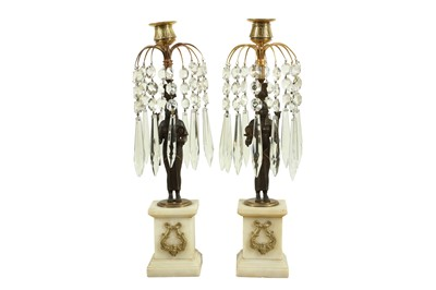 Lot 107 - A PAIR OF REGENCY EGYPTIAN REVIVAL BRONZE AND CUT GLASS CANDLESTICKS