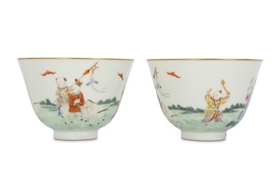 Lot 14 - A PAIR OF CHINESE FAMILLE ROSE 'NEW YEAR' CUPS.