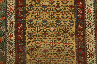 Lot 8 - AN ANTIQUE SOUTH CAUCASIAN LONG RUG