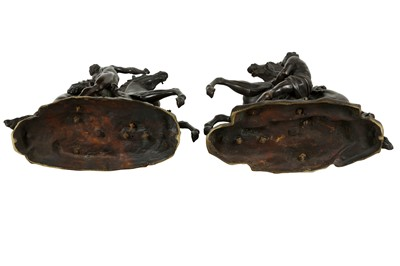 Lot 56 - AFTER GUILLAUME COUSTOU, FRENCH (1677-1746): A PAIR OF LATE 19TH CENTURY CENTURY PATINATED BRONZE MODELS OF THE MARLEY HORSES