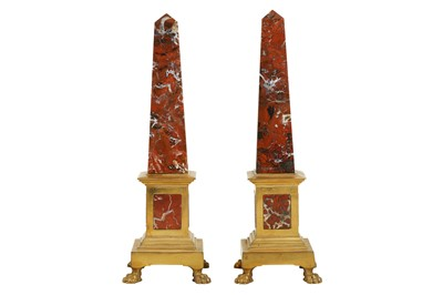 Lot 105 - A PAIR OF MID 19TH CENTURY GRAND TOUR ROUGE MARBLE AND ORMOLU MOUNTED OBELISKS