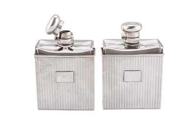 Lot 70 - A pair of Edwardian/George V Art Deco sterling silver mounted glass cologne or scent bottles, London 1907/12 by Samuel Jacob