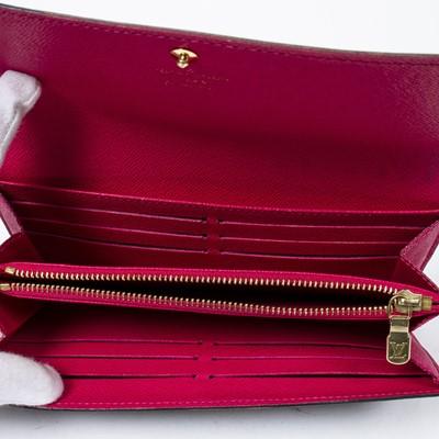 Lot 21 - Louis Vuitton Evasion Sarah 10 Wallet