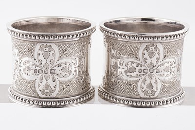 Lot 46 - A cased pair of Victorian sterling silver napkin rings, 1895 by Henry Atkin