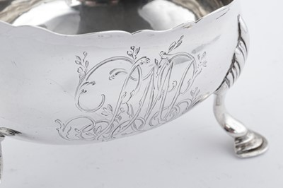 Lot 512 - A George III sterling silver sauceboat, London 1766 by James Waters (free. 24th March 1737)