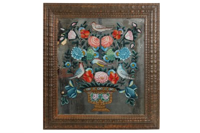 Lot 71 - TWO MIDDLE EASTERN QAJAR REVERSE PAINTED GLASS PANELS DEPICTING BIRDS AND FLOWERS