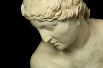 Lot 20 - A LARGE CARVED MARBLE FIGURE OF THE CROUCHING VENUS, AFTER THE ANTIQUE