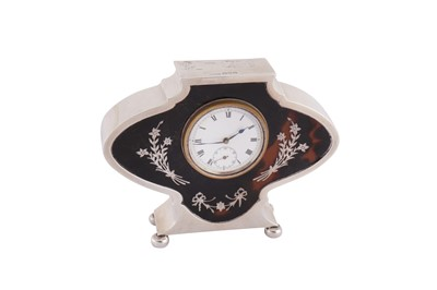 Lot 53 - A George V sterling silver and tortoiseshell desk clock, Chester 1920 by S W Goode & Co