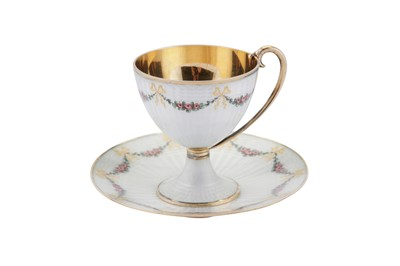 Lot 84 - An early 20th century Norwegian 930 standard silver gilt and guilloche enamel cup and saucer, Bergen circa 1910 by Marius Hammer