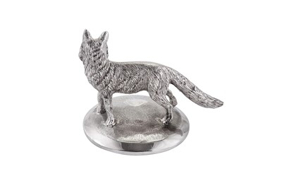 Lot 30 - A modern cast unmarked silver model of a fox
