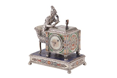 Lot 88 - An early 20th century Austrian unmarked silver and champlevé enamel figural table timepiece, probably Vienna circa 1910