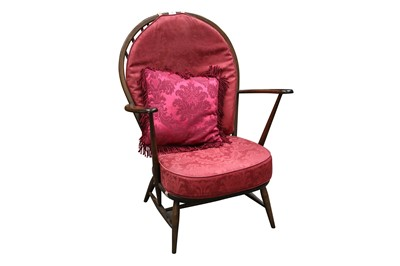 Lot 58 - AN ERCOL STAINED BEECH ARMCHAIR, 20TH CENTURY