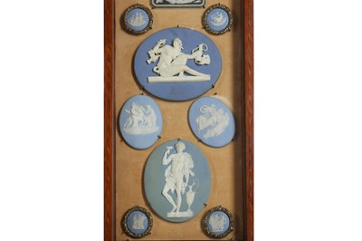 Lot 83 - A COLLECTION OF 19TH CENTURY WEDGWOOD JASPERWARE INTAGLIOS IN A CABINET