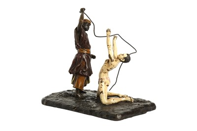 Lot 1042 - FRANZ BERGMAN (IN THE MANNER OF) A COLD PAINTED BRONZE MODEL OF A SLAVE TRADER AND NUDE SLAVE