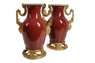 Lot 95 - A PAIR OF LATE  19TH  CENTURY SANG DE BOEUF CHINESE PORCELAIN AND GILT BRONZE MOUNTED VASES