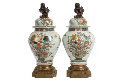 Lot 98 - A PAIR OF LATE 19TH / EARLY 20TH CENTURY GILT BRONZE MOUNTED IMARI PORCELAIN VASES
