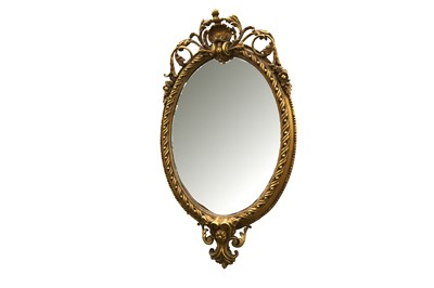 Lot 59 - AN OVAL GILTWOOD AND GESSO MIRROR, IN THE FRENCH TASTE, 20TH CENTURY