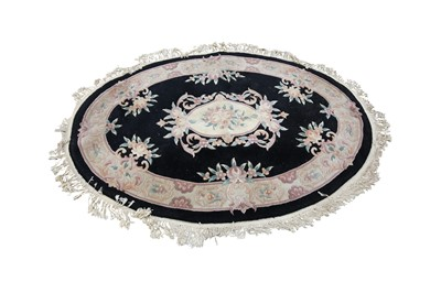Lot 63 - A CHINESE OVAL WOOL RUG, 20TH CENTURY