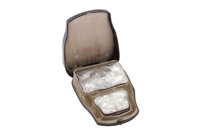 Lot 68 - A cased late 19th century French unmarked silver mounted mother of pearl purse and aide memoire, circa 1890