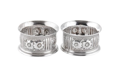 Lot 47 - A cased pair of Victorian sterling silver napkin rings, London 1896 by Horace Woodward & Co Ltd