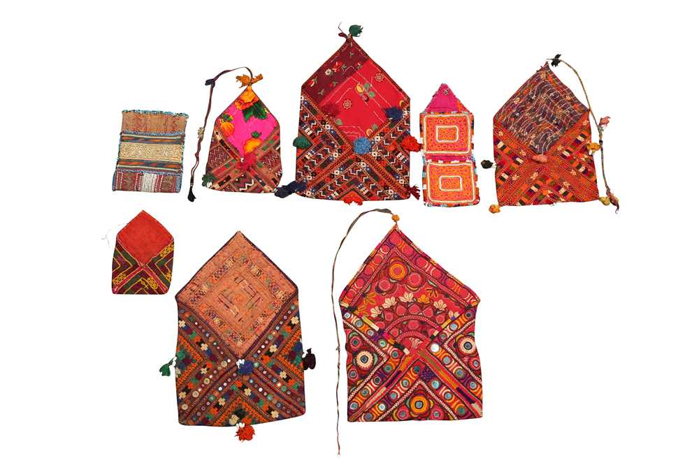 Lot 26 - A COLLECTION OF BALOCH BHUJKI (DOWRY BAGS) AND OTHER TEXTILES