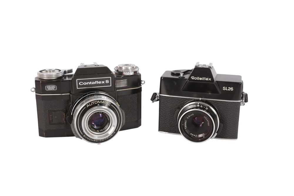 Lot 32 - A Pair of Black SLR Cameras