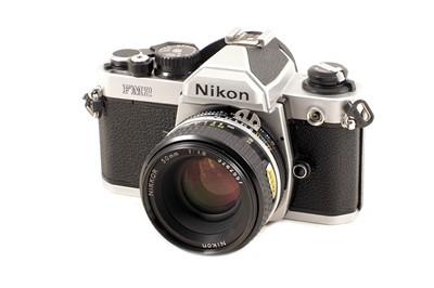 Lot 36 - A 3-Lens Nikon FM2n Film Camera Outfit.