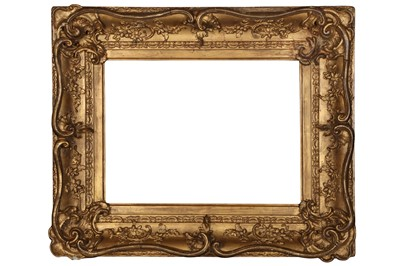 Lot 187 - A LOUIS XV STYLE SWEPT AND GILDED COMPOSITION FRAME