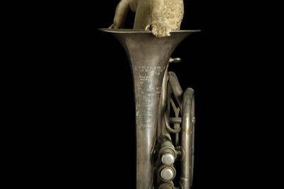 Lot 90 - TAXIDERMY ART:  LION CUB IN A TRUMPET BY ANDRE ROBOLOBAVICH