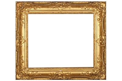 Lot 189 - A LOUIS XV STYLE SWEPT AND GILDED COMPOSITION FRAME