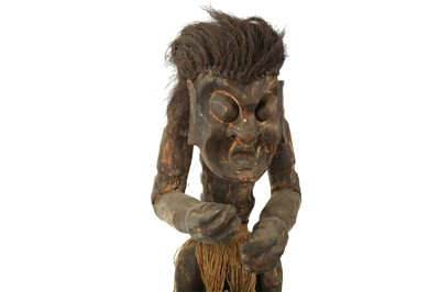 Lot 40 - A CARVED WOODEN TRIBAL FIGURE