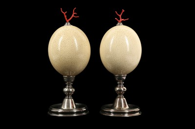 Lot 25 - A PAIR OF MID-CENTURY OSTRICH EGGS MOUNTED WITH MEDITERRANEAN CORAL