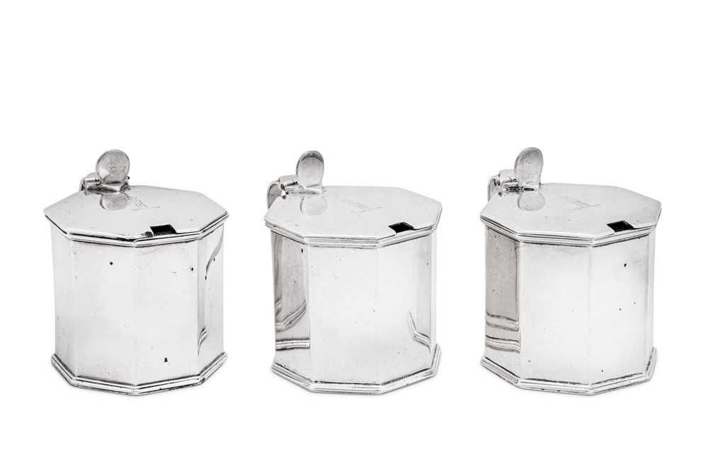 Lot 471 - A set of three George V sterling silver mustard pots, London 1911 by Sebastian Garrard