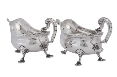Lot 509 - A near pair of George II/III sterling silver sauceboats, one London 1764 by William Grundy