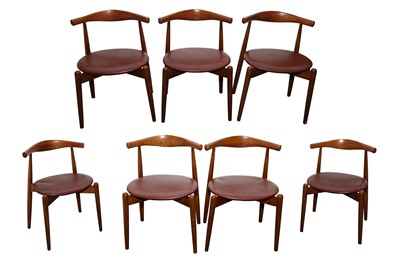 Lot 20 - A SET OF SEVEN TEAK DINING CHAIRS
