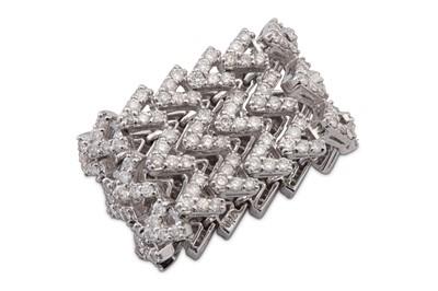 Lot 10 - A flexible diamond eternity ring