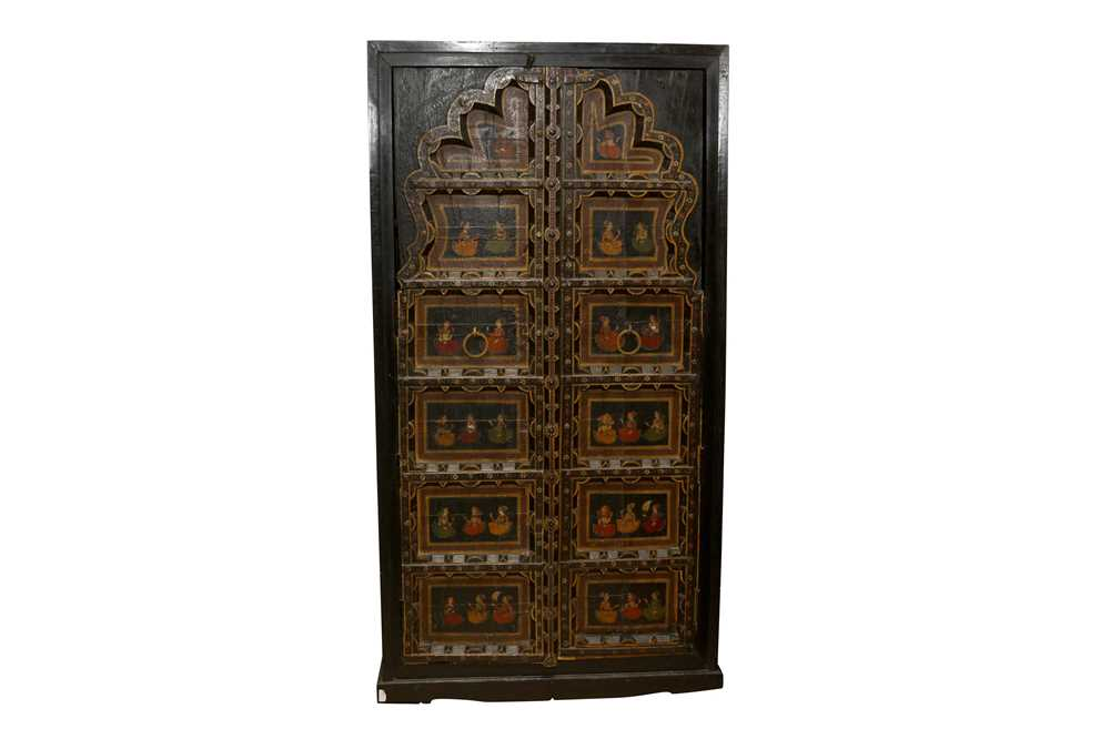 Lot 48 - A PAIR OF INDIAN WINDOW SHUTTERS INCORPORATED INTO A LATER RAJASTHANI CUPBOARD
