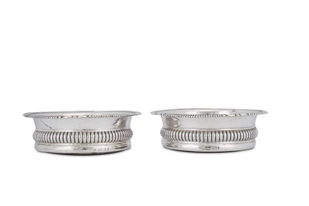 Lot 495 - A pair of George IV sterling silver wine coasters, Sheffield 1828 by John and Thomas Settle