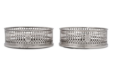 Lot 508 - A pair of George III sterling silver wine coasters, London 1773 by I.W possibly for John Weldring (Grimwade 3699)