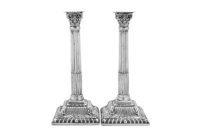 Lot 507 - A pair of early George III sterling silver candlesticks, London 1760 by Louis Black (reg. 30th July 1756)