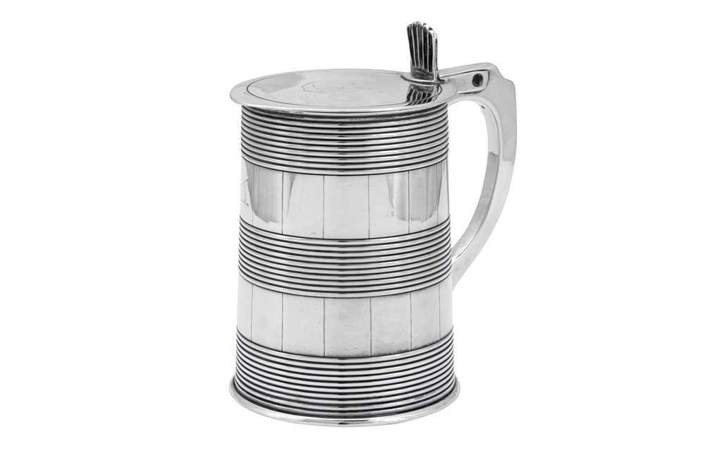 Lot 505 - A George III sterling silver quart tankard, London 1783 by Thomas Chawner (this mark reg. 31st May 1783)