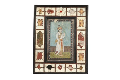 Lot 61 - λ A PORTRAIT OF AN INDIAN PRINCE WITH A PARAKEET