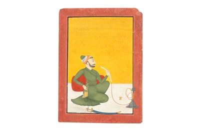 Lot 74 - A SEATED PORTRAIT OF RAJA AJMAT DEV OF MANKOT (R. 1730-1760)