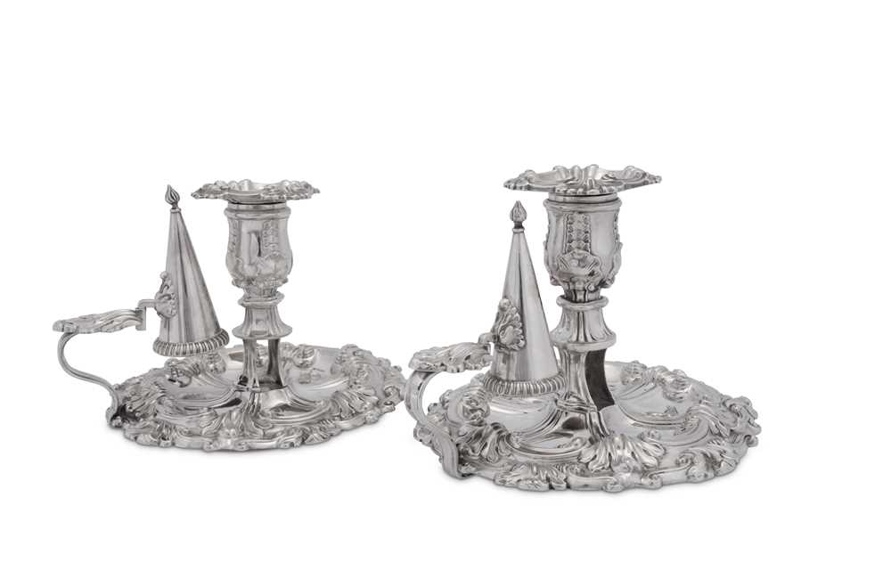 Lot 494 - A pair of George III and George IV sterling silver chambersticks, Sheffield 1814/27 by James Kirkby, Waterhouse & Co and Waterhouse, Hodson & Co respectively
