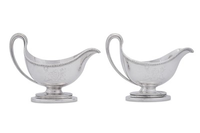 Lot 513 - Earl of Burlington - A pair of George III sterling silver sauceboats, London 1784 by Edward Wakelin and William Taylor (reg. 25th Sep 1776)