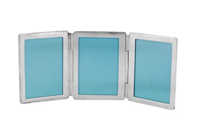 Lot 42 - A late 20th century small American sterling silver triple photograph frame, New York by Tiffany and Co, import marks for London 1998