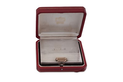 Lot 40 - A mid-20th century French 950 standard silver and 18 carat gold mounted compact, Paris dated 1954, retailed by Cartier